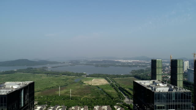 aerial wuxi coast city commercial buildings - curtain wall facade stock videos and b-roll footage