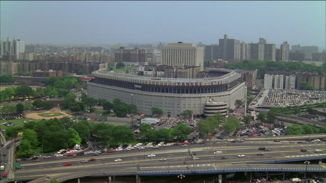 aerial yankee stadium and surrounding area / over yankee stadium during game / new york city - ニューヨーク・ヤンキース点の映像素材/bロール