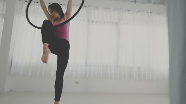 aerial yoga with hoop - leotard stock videos & royalty-free footage