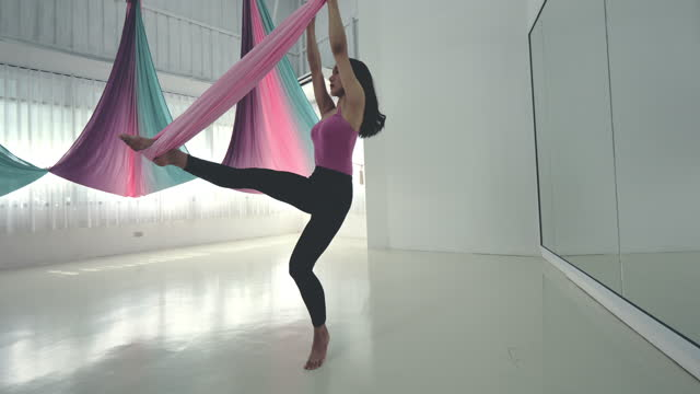 aerial yoga woman practicing - plank stock videos & royalty-free footage