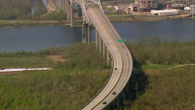 aerial zoom in military vehicles crossing intracoastal waterway bridge / new orleans louisiana - elevated road stock videos & royalty-free footage