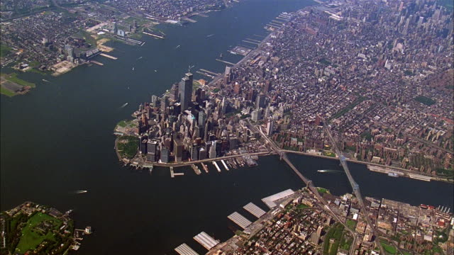 aerial zoom in moving towards lower manhattan and world trade center / new york city - river hudson stock videos & royalty-free footage