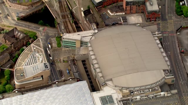 aerial zoom in of the manchester arena the morning after a terrorist bombing at a pop concert - manchester arena stock videos & royalty-free footage