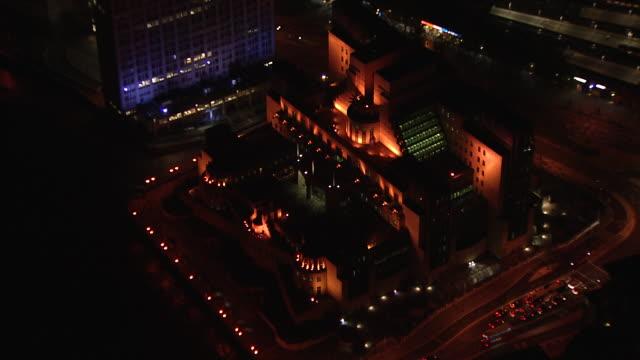 Aerial zoom in on MI6 building, Vauxhall, London.