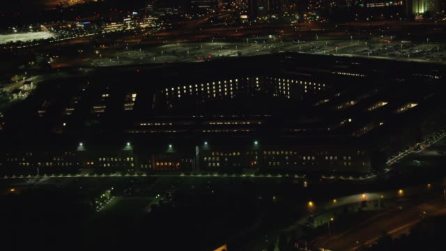 aerial zoom in on the pentagon, night washington dc  - arlington virginia stock videos and b-roll footage