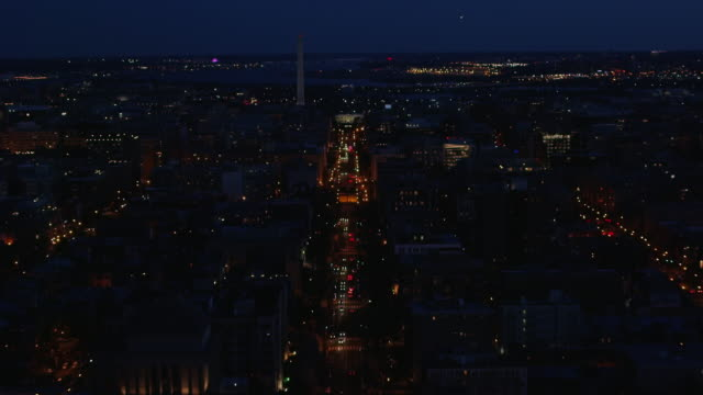 aerial zoom in on the white house from wide shot of dc at night - tall high stock videos & royalty-free footage