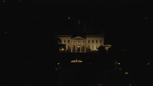 aerial zoom in on the white house from wide shot of dc night - white house washington dc stock videos & royalty-free footage