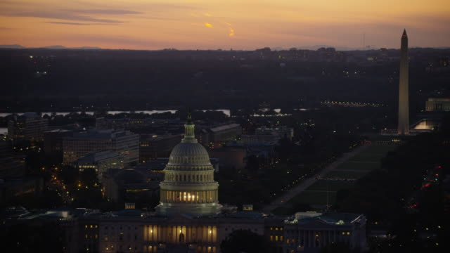 Aerial zoom in on United States Capitol, sunset Washington DC
