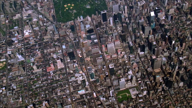 aerial zoom in over manhattan near central park / new york city - 1993 stock videos & royalty-free footage