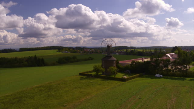 aerial zoom in shot of windmill in rural landscape / drnovice, czech republic - czech republic stock videos & royalty-free footage