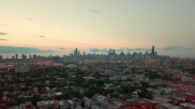 aerial, zoom out, chicago skyline at sunset, usa - chicago illinois stock videos & royalty-free footage