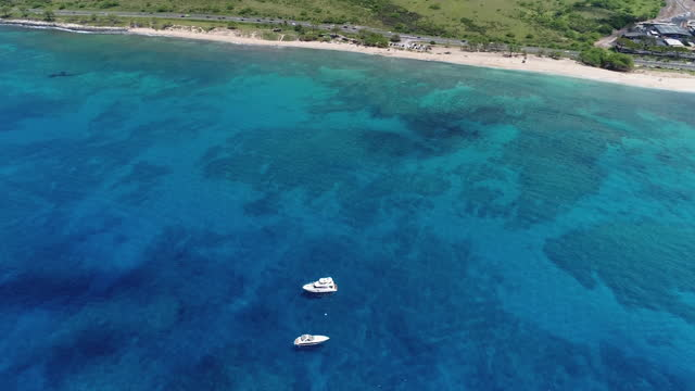 aerial, zoom out, cruise boats anchored off the coast of oahu, hawaii, usa - anchored stock videos & royalty-free footage
