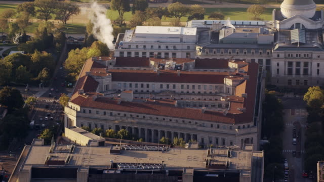 aerial zoom out from department of justice, washington dc daytime - smithsonian institution stock videos & royalty-free footage