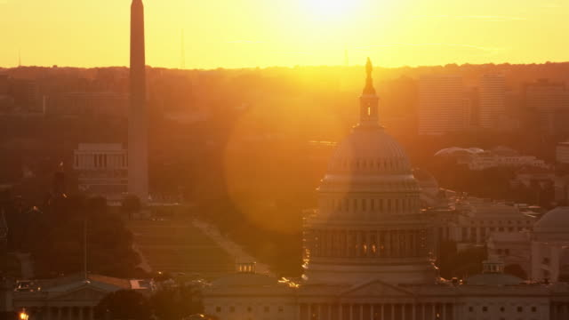 Aerial zoom out from United States Capitol Building, Sunset Washington D.C.