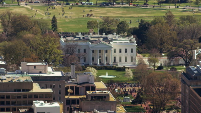 aerial zoom out from white house to reveal surrounding dc - monument stock videos & royalty-free footage