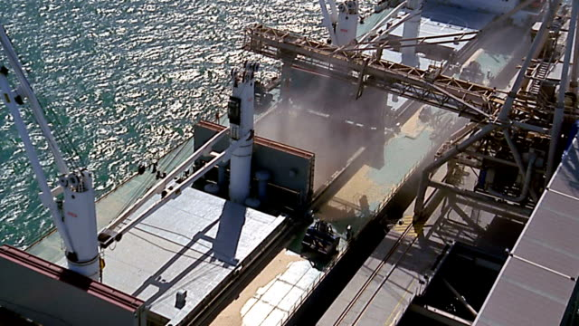 aerial zoom out grain being loaded onto ships / geelong, australia - unknown gender stock videos & royalty-free footage