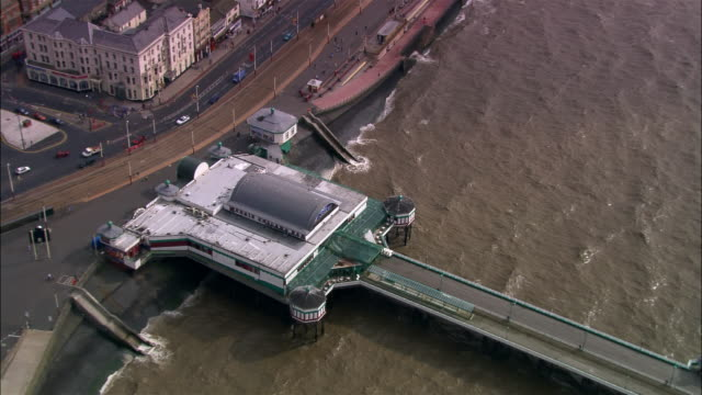aerial zoom out north pier and coastline/ blackpool, england - blackpool stock-videos und b-roll-filmmaterial