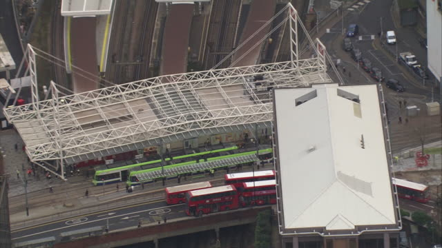 aerial zoom out of an entrance to east croydon station, showing buses, trams, station platforms and surrounding buildings, croydon, outer london, uk. - connection stock videos & royalty-free footage