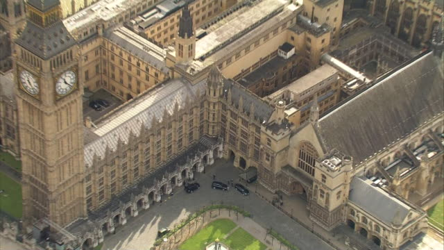 Aerial zoom out of Chancellor of the Exchequer George Osborne arriving at the Houses of Parliament to deliver the budget