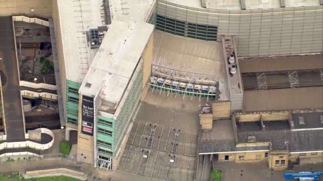 aerial zoom out of the manchester arena the morning after a terrorist bombing at a pop concert - manchester arena stock videos & royalty-free footage