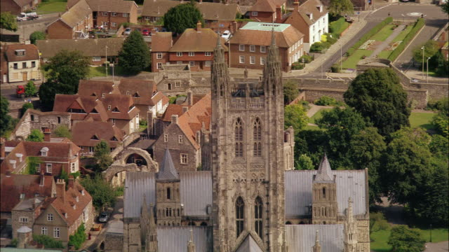 aerial zoom out over canterbury cathedral and the city of canterbury / kent, england - canterbury cathedral stock videos & royalty-free footage