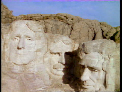 aerial zoom out over mount rushmore / south dakota - mt rushmore national monument stock videos and b-roll footage
