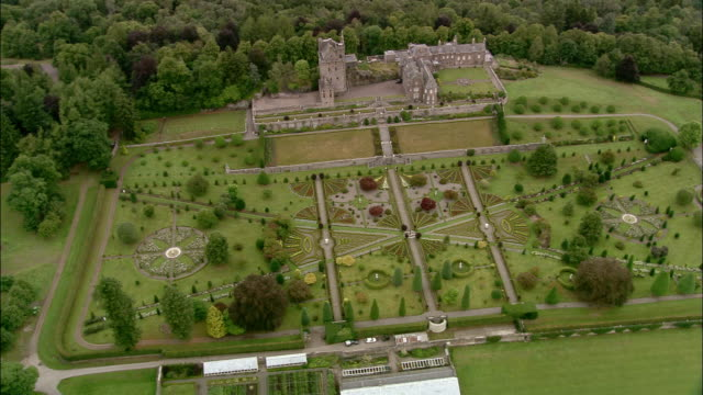 Aerial zoom out over the formal garden at Drummond Castle / Crieff, Scotland