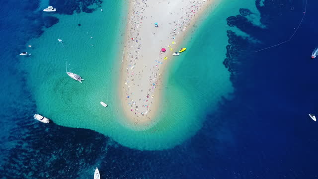 aerial, zoom out, people on a sandy islet, croatia - croatia stock videos & royalty-free footage