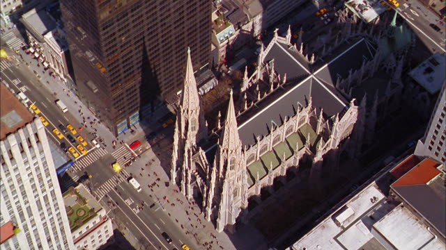 aerial zoom out st. patrick's cathedral and fifth avenue - st. patrick's cathedral manhattan stock videos and b-roll footage