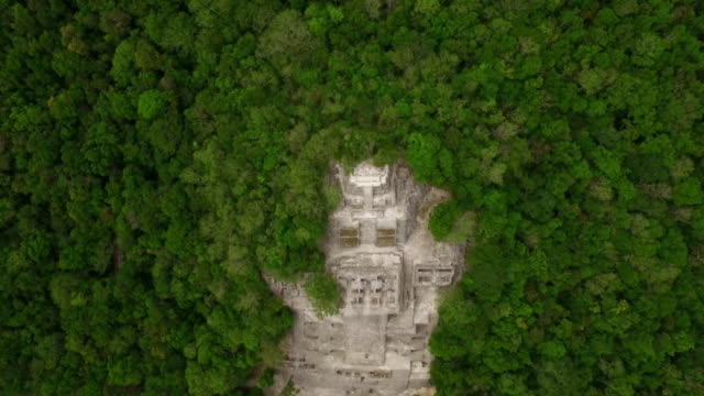 aerial zoom out to reveal mayan ruin, mexico - zoom out stock videos & royalty-free footage