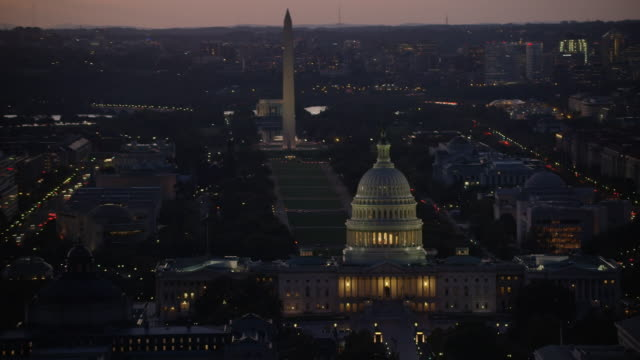 aerial zoom out united states capitol, sunset washington dc - washington monument washington dc stock videos & royalty-free footage