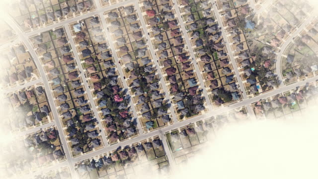 aerial zoom out view of repeated suburban houses in texas with the planet earth and outer space view. - zoom out stock videos & royalty-free footage