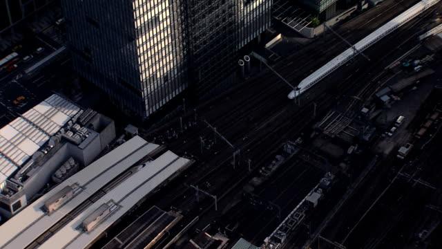 aerial zoom tgv shinkansen aerodynamic train tokyo railway - shinkansen stock videos & royalty-free footage