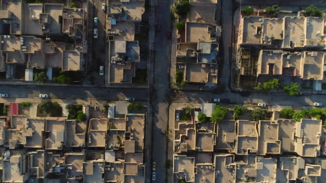 aerial zoomin on a neighbourhood in mosul iraq - mosul stock videos and b-roll footage