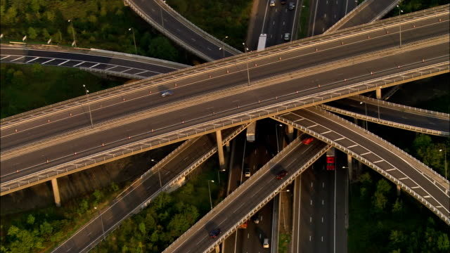 Aerial zooming out from junction of M25 and M23 / Surrey, England