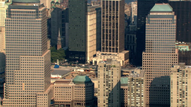 aerial zoom-out from former world trade center site. shot in 2003. - september 11 2001 attacks stock videos and b-roll footage