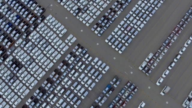 aerial:auto export car wait for deliver - car rental stock videos and b-roll footage