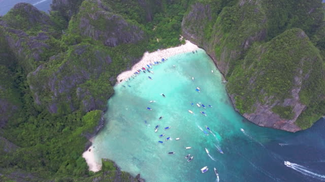 aerial:beach in the group of mountain ,maya krabi thailand - latin american civilizations stock videos and b-roll footage