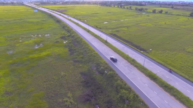 aerial:black suv driving along the road - sports utility vehicle stock videos and b-roll footage