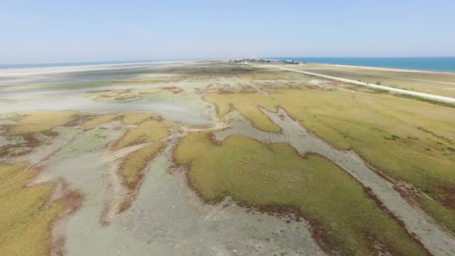 aerial:flight above salt marshes - nature reserve stock videos & royalty-free footage