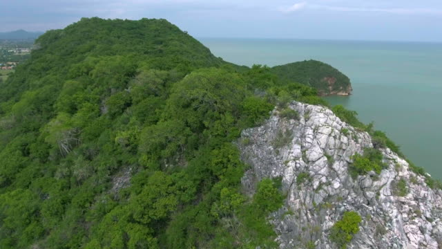 aerial:flying over the tropical island - extreme terrain stock videos and b-roll footage