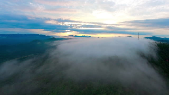 Aerial:Fog flowing over mountains