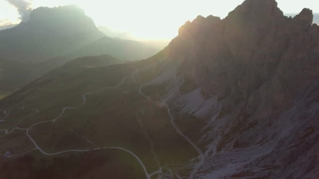 aerial:in to the mountain - motorway junction stock videos & royalty-free footage