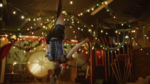 aerialist performing on hanging hoop in nightclub / provo, utah, united states - fishnet stock videos and b-roll footage