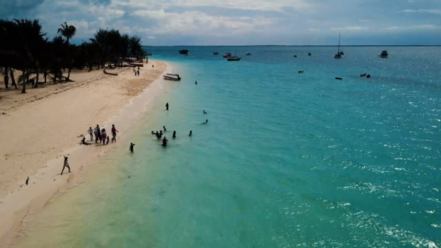 aerial/local african children playing in tranquil paradise beach, zanzibar - idyllic stock videos & royalty-free footage