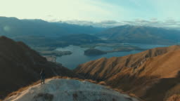 Aerial:Man at top mountain