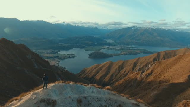 aerial:man at top mountain - on top of stock videos & royalty-free footage