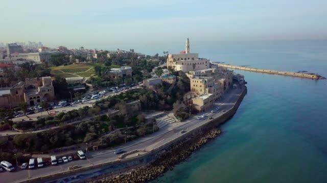 aerial/mediterranean coastline of tel aviv jaffa with beaches and promenade, israel - jaffa bildbanksvideor och videomaterial från bakom kulisserna