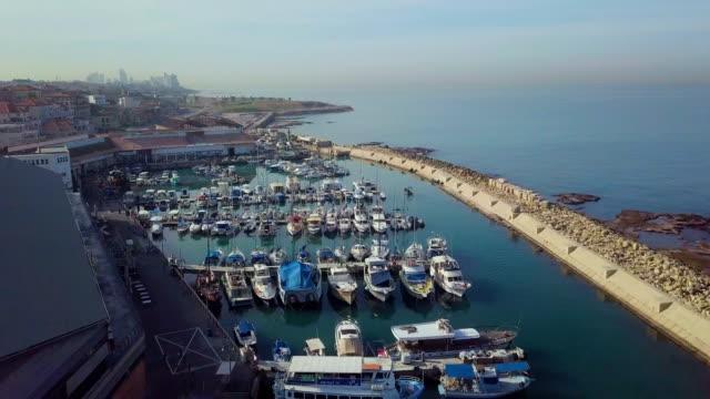aerial/mediterranean coastline of tel aviv jaffa with marina and boats, israel - jaffa bildbanksvideor och videomaterial från bakom kulisserna
