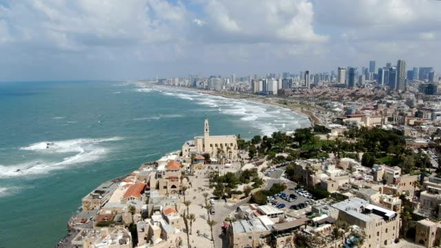 aerial/mediterranean tel aviv coastline with hotels, beaches and marina, israel - テルアビブ点の映像素材/bロール